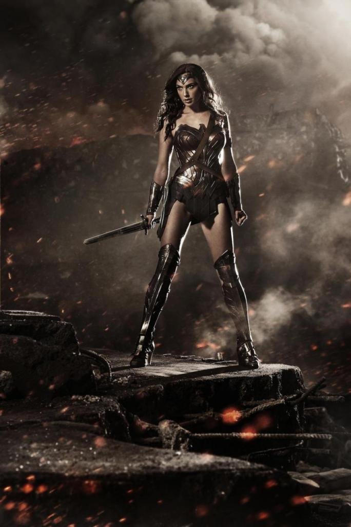 HERE IS SPINDLY-ARMED GAL GADOT SUPPOSEDLY AS A POWERFUL AMAZONIAN BROAD. R.O.T.O.R. HAS SEEN MORE MUSCLE ON JOHN CANDY'S CORPSE.